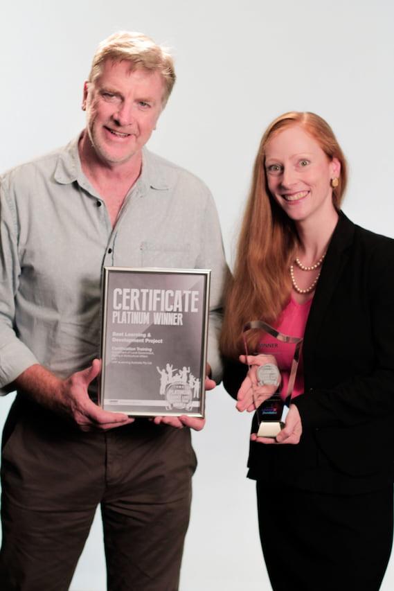 Ian Chapman and Ruth Schwarzenbock elearning award winners with torphy
